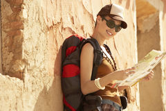 Hiker Reading Map By Farmhouse Stock Photography