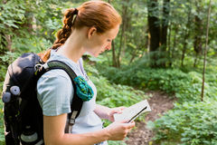 Hiker Reading a Map in a Forest Royalty Free Stock Photos