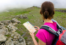 A hiker reading a map Royalty Free Stock Photo
