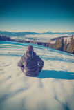 Hiker relaxing on a fresh snow. Vintage colors Royalty Free Stock Photos