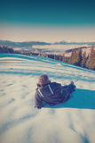 Hiker relaxing on a snow. Vintage colors Royalty Free Stock Image