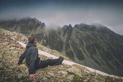 Hiker relaxing on top of a mountain. Instagram stylization Stock Photography