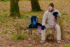 Hiker resting on bench Stock Photos
