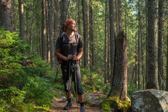 Hiker is resting in coniferous forest. Royalty Free Stock Photography