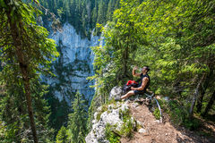 Hiker resting and drinking water Royalty Free Stock Image