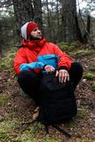 Hiker resting in the forest. Hiker have short respite on his way in the forest Royalty Free Stock Images