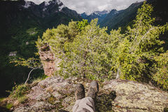 An hiker resting into the forest in a rainy day Alps Italy Stock Photography