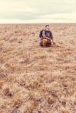 Hiker resting in grassland Stock Photos