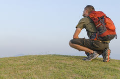 Hiker Resting on Hill Stock Photos