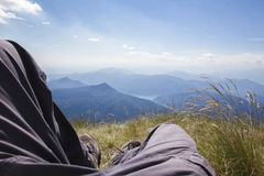 Hiker resting on mountain top Stock Photos