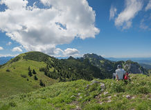 Hiker resting at the mountain top Stock Images