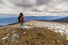 Hiker resting on the mountain top Royalty Free Stock Photo