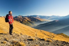 Hiker resting on the mountain top Stock Photo