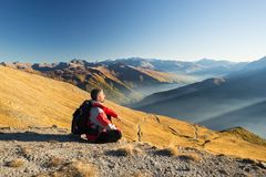Hiker resting on the mountain top Stock Image