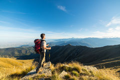 Hiker resting on the mountain top Royalty Free Stock Photos