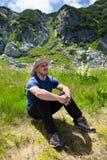 Hiker resting near mountain Stock Photos