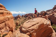 Hiker rests in Arches National park in Utah, USA Stock Photo