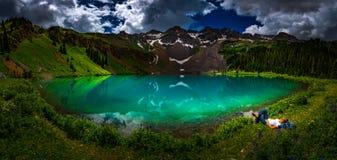 Hiker rests near Blue Lake Ridgway Colorado stock photography