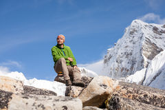 Hiker rests on the trek in Himalayas, Nepal Royalty Free Stock Photo
