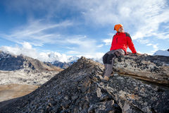 Hiker rests on the trek in Himalayas, Nepal Royalty Free Stock Photography