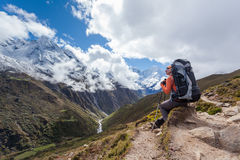 Hiker rests on trek in Himalayas. Nepal Royalty Free Stock Photo
