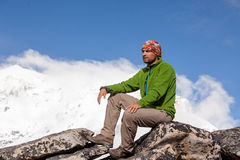 Hiker rests on the trek in Himalayas, Nepal Royalty Free Stock Image