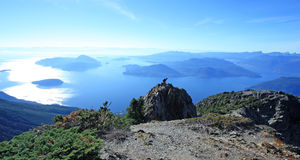Hiker on the ridge of Mount Brunswick in Cypress Provincial Park Royalty Free Stock Photography