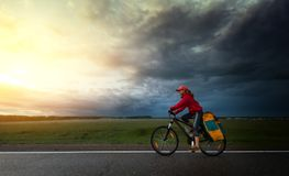 Hiker riding the bike Royalty Free Stock Photography
