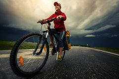 Hiker riding the bike Royalty Free Stock Image