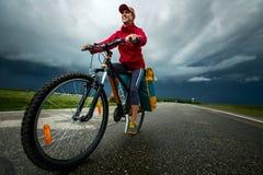 Hiker riding the bike Royalty Free Stock Photos