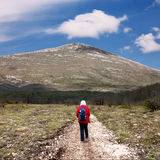 Hiker on the road to the mountain Rtanj in Serbia Royalty Free Stock Image