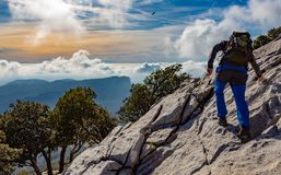 Hiker on rock royalty free stock photos