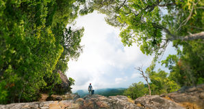 Hiker on the rock Royalty Free Stock Image