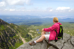 Hiker on the rock royalty free stock photography