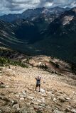 Hiker on rocky hillside  Royalty Free Stock Photos