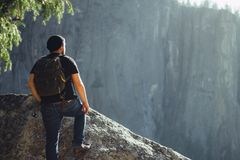 Hiker on rocky ledge Royalty Free Stock Photos