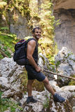 Hiker on a rocky mountains Stock Photography