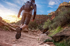 Hiker on the rocky path Stock Images