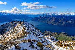 Roy`s Peak covered with snow in winter, Wanaka, New Zealand stock images