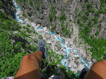 Hiker`s first person perspective photo at the edge of a cliff. Stock Photo