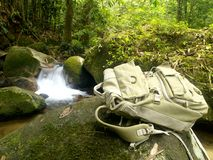 Hiker's Traveller Backpack. A full backpack with a small waterfall in the background Stock Photos