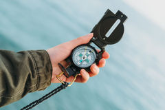 Hiker searching direction with a compass Royalty Free Stock Photography