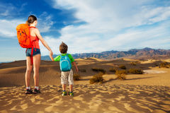 Hiker with selfie stick and son, Death valley Stock Photos