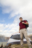 Hiker sets up camp. With tents and fire pit stock photos