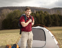 Hiker sets up camp. With tents and fire pit stock photography