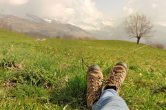 Hiker shoes in the grass Royalty Free Stock Images