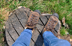 Hiker shoes on wooden Royalty Free Stock Photography