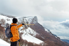 Hiker showing direction Royalty Free Stock Photo