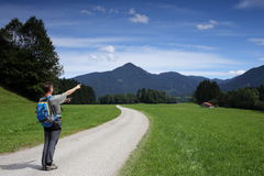 Hiker is showing Royalty Free Stock Image