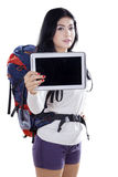Hiker shows tablet in studio Stock Images